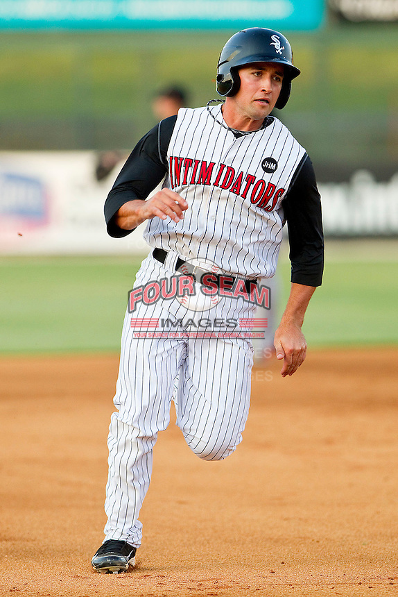 Drew Lee #11 of the Kannapolis Intimidators hustles towards third base against the Delmarva Shorebirds at Fieldcrest Cannon Stadium on May 21, 2011 in Kannapolis, North Carolina.   Photo by Brian Westerholt / Four Seam Images