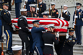 A joint service honor guard carries the casket of former US President George H.W. Bush out of the US Capitol in Washington, DC, USA, 05 December 2018. George H.W. Bush, the 41st President of the United States (1989-1993), died at the age of 94 on 30 November 2018 at his home in Texas.<br /> Credit: Shawn Thew / Pool via CNP