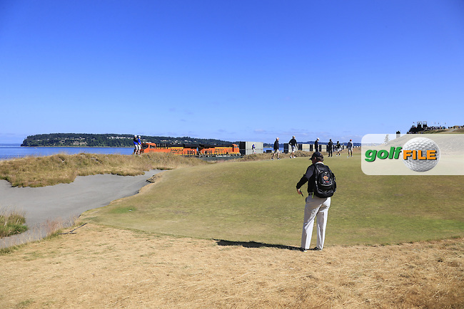 Freight train speeds by the 17th green during Wednesday's Practice Day of the 2015 U.S. Open 115th National Championship held at Chambers Bay, Seattle, Washington, USA. 6/17/2015.<br /> Picture &copy; Golffile/Eoin Clarke