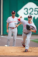 Louisville Bats pitching coach Ted Power (48) watches starting pitcher Jon Moscot (45) in the bullpen before a game against the Buffalo Bisons on June 20, 2016 at Coca-Cola Field in Buffalo, New York.  Louisville defeated Buffalo 4-1.  (Mike Janes/Four Seam Images)