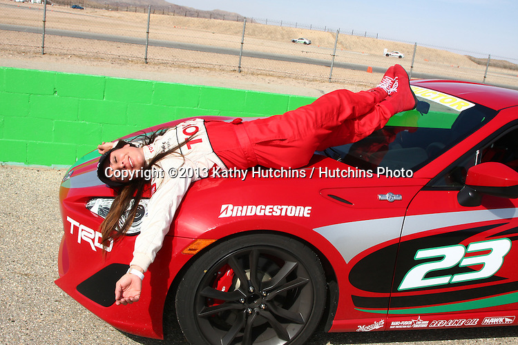 LOS ANGELES - MAR 23:  Kate del Castillo with the Scion FR-S at the 37th Annual Toyota Pro/Celebrity Race training at the Willow Springs International Speedway on March 23, 2013 in Rosamond, CA          EXCLUSIVE PHOTO
