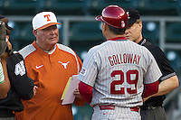 Texas Longhorns coach Auggie Garrido meets with  Oklahoma Sooners coach Sunny Golloway #29 before the NCAA baseball game on April 5, 2013 at UFCU DischFalk Field in Austin Texas. Oklahoma defeated Texas 2-1. (Andrew Woolley/Four Seam Images).