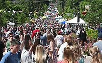 NWA Democrat-Gazette/J.T. WAMPLER People fill Block Ave. from the square to Dickson St. Sunday May 21, 2017 during the Seventh annual Block Street Block Party.  Thousands of people attended with around 150 vendors, 90 bands, several beer gardens and more.