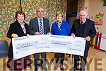 The Mid Kerry Vintage Rally committee present cheques to  Recovery Haven and UHK Oncology at the Castlemaine Community centre on Tuesday night.<br /> L to r: Mary Fitzgerald (Oncology), Denis Tagney (Mid Kerry Vintage Society),  Maureen O&rsquo;Brien (Recovery Haven) and Michael McKenna (Mid Kerry Vintage Rally)