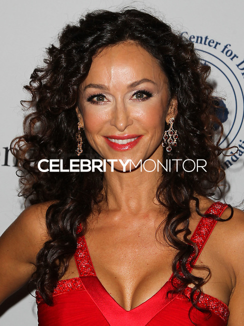 BEVERLY HILLS, CA, USA - OCTOBER 11: Sofia Milos arrives at the 2014 Carousel Of Hope Ball held at the Beverly Hilton Hotel on October 11, 2014 in Beverly Hills, California, United States. (Photo by Celebrity Monitor)