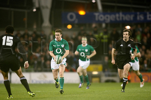 20.11.2010 International Rugby Union from Landsdowne Road Dublin. Ireland v New Zealand. Eoin Reddan looking to kick or run with Mils Muliaina lining him up for a tackle and Conrad Smith backing up for New Zealand.