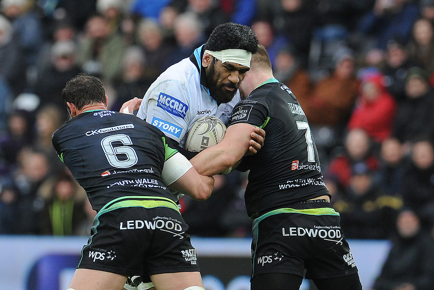 Glasgow Warriors' Brian Alainu'uese is tackled by Ospreys' Olly Cracknell and Tyler Ardron<br /> <br /> Photographer Ian Cook/CameraSport<br /> <br /> Guinness PRO12 Round 16  - Ospreys v Glasgow Warriors - Sunday 26th February 2017 - Liberty Stadium - Swansea<br /> <br /> World Copyright &copy; 2017 CameraSport. All rights reserved. 43 Linden Ave. Countesthorpe. Leicester. England. LE8 5PG - Tel: +44 (0) 116 277 4147 - admin@camerasport.com - www.camerasport.com