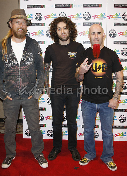 "2 July 2008 - Las Vegas, Nevada - Chris Martin, guest, and Scott Ian. Annie Duke and Don Cheadle host the 2nd Annual ""Ante Up For Africa"" Celebrity Poker Tournament during the 2008 World Series of Poker held at the Rio All-Suite Hotel and Casino. Photo Credit: MJT/AdMedia"