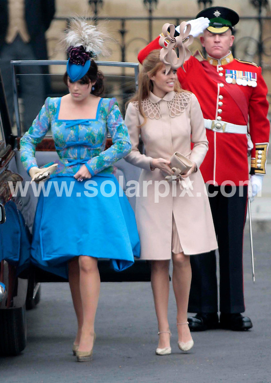 **ALL ROUND PICTURES FROM SOLARPIX.COM**                                             **NO UK NEWSPAPER PUBLICATION**.**UK MAGAZINE & SUPPLEMENT PUBLICATION ONLY** AND NO PUBLICATION IN AUSTRALIA, BELGIUM, FRANCE, GERMANY, ITALY, SCANDINAVIA AND USA**                                                                                  Caption: Kate Middleton arrives at Westminster Abbey for her marriage to Prince William. London, UK. 29 April 2011                                                                              This pic: Princess Eugenie and Prince Beatrice                                              JOB REF: 13229 SFE       DATE: 29_04_2011                                                           **MUST CREDIT SOLARPIX.COM OR DOUBLE FEE WILL BE CHARGED**                                                                      **MUST AGREE FEE BEFORE ONLINE USAGE**                               **CALL US ON: +34 952 811 768 or LOW RATE FROM UK 0844 617 7637**