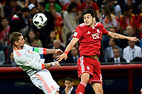 KAZAN - RUSIA, 20-06-2018: Sardar AZMOUN (Der) jugador de RI de Irán disputa el balón con Sergio RAMOS (C) (Izq) jugador de España durante partido de la primera fase, Grupo B, por la Copa Mundial de la FIFA Rusia 2018 jugado en el estadio Kazan Arena en Kazán, Rusia. /  Sardar AZMOUN (R) player of IR Iran fights the ball with Sergio RAMOS (C) (L) player of Spain during match of the first phase, Group B, for the FIFA World Cup Russia 2018 played at Kazan Arena stadium in Kazan, Russia. Photo: VizzorImage / Julian Medina / Cont