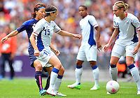 August 06, 2012..Japan's Yuki Ogimi #17, and France's Elise Bussaglia #15 during Semi Final match at the Wembley Stadium on day ten in Wembley, England. Japan defeats France 2-1 to reach Women's Finals of the 2012 London Olympics.