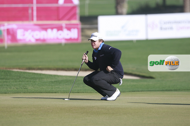 George Coetzee (RSA) waits to resume play on the 18th green during Saturday's Round 2 of the 2012 Commercialbank Qatar Masters presented by Dolphin Energy at Doha Golf Club, Qatar, 4th February 2012 (Photo Eoin Clarke/www.golffile.ie)