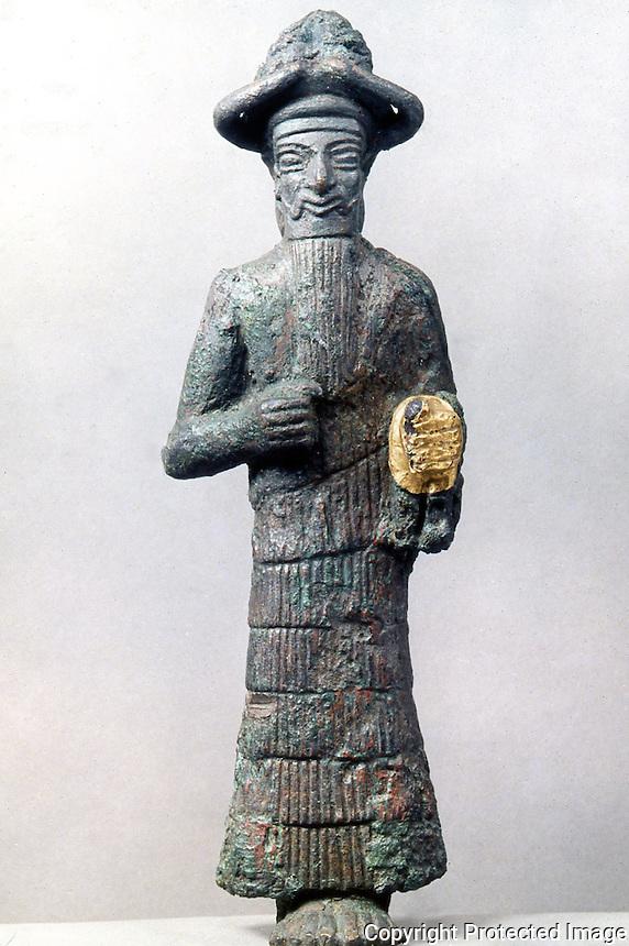 World Civilization:  Suse--a God, Barbu.   Bronze statue.  Louvre, Paris.