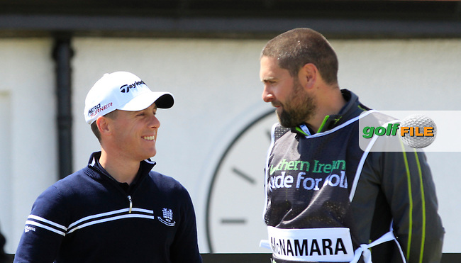 Cian McNamara (IRL) and his caddy Kenny Fahey the GUI Academy Head Pro on the 10th during Round 1 of the 2015 Dubai Duty Free Irish Open, Royal County Down Golf Club, Newcastle Co Down, Northern Ireland. 28/05/2015<br /> Picture Thos Caffrey, www.golffile.ie