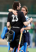 Hampstead goalkeeper Ian Scanlon gets a pat from Jaime Gonzalez-Laguillo at the end of the England Hockey League Mens Semi-Final Cup game between Hampstead & Westminster and Sevenoaks at the Paddington Recreation Ground, Maida Vale on Sun March 21, 2010