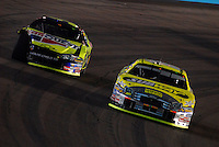 Apr 22, 2006; Phoenix, AZ, USA; Nascar Nextel Cup driver Greg Biffle of the (16) Subway/National Guard Ford Fusion passes Kyle Busch during the Subway Fresh 500 at Phoenix International Raceway. Mandatory Credit: Mark J. Rebilas-US PRESSWIRE Copyright © 2006 Mark J. Rebilas..