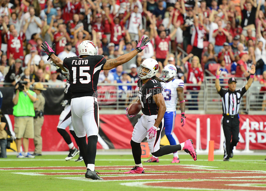 Oct. 14, 2012; Glendale, AZ, USA; Arizona Cardinals wide receiver (11) Larry Fitzgerald scores a touchdown in the second half against the Buffalo Bills at University of Phoenix Stadium. Mandatory Credit: Mark J. Rebilas-