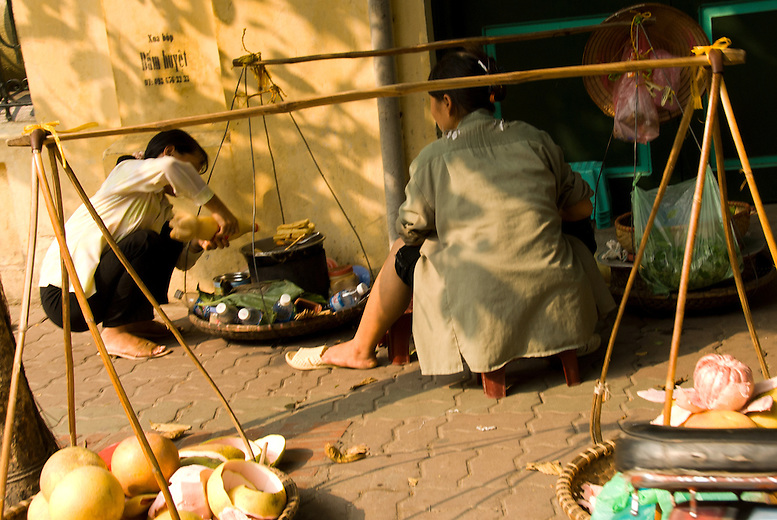 Women walk along the streets selling their goods from their bamboo poles carried over their shoulders. Vietnam is often described using a bamboo pole metaphor with the north being the top rice basket, the long narrow strip of land representing the bamboo pole and the south with the Mekong Delta representing the second, larger rice basket.