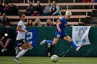 Seattle, WA - Sunday, September 11 2016: Seattle Reign FC forward Megan Rapinoe (15) crosses the ball during a regular season National Women's Soccer League (NWSL) match between the Seattle Reign FC and the Washington Spirit at Memorial Stadium. Seattle won 2-0.