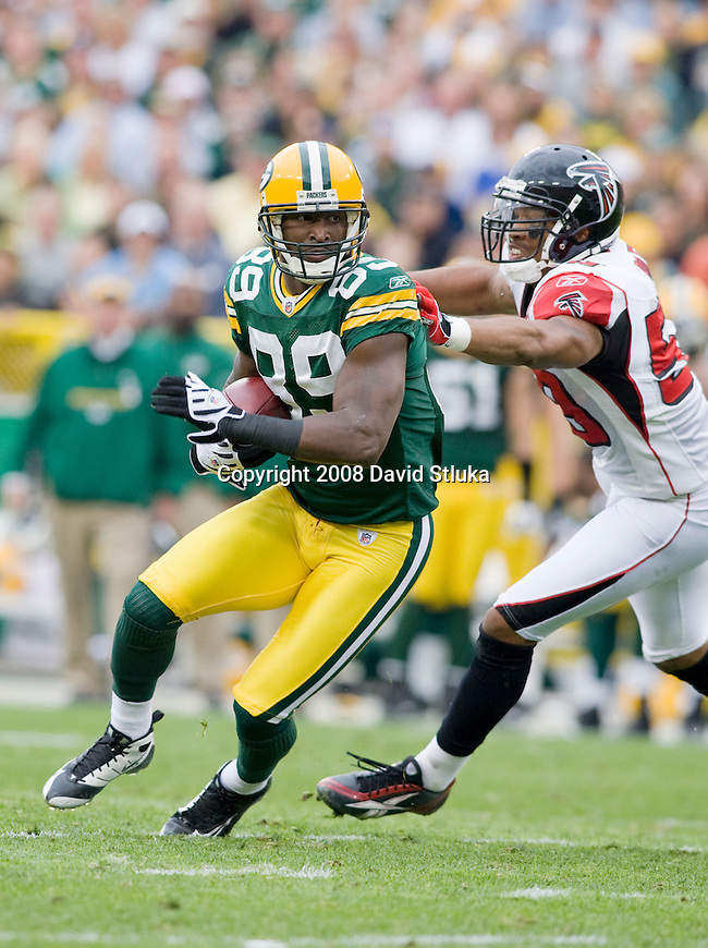 GREEN BAY, WI - OCTOBER 5: Wide receiver James Jones #89 of the Green Bay Packers gains yardage against the Atlanta Falcons at Lambeau Field on October 5, 2008 in Green Bay, Wisconsin. The Falcons beat the Packers 27-24. (Photo by David Stluka)