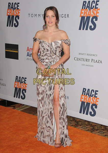 SOPHIA BUSH .at the 17th Annual Race to Erase MS held at The Hyatt Regency Century Plaza in Beverly Hills, California, USA, May 7th 2010..full length white long maxi dress strapless off the shoulder hair up grey gray print brown slit split open toe shoes clutch bag ring green.CAP/RKE/DVS.©DVS/RockinExposures/Capital Pictures.