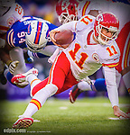 9 November 2014: Kansas City Chiefs quarterback Alex Smith scrambles in the backfield during the fourth quarter against the Buffalo Bills at Ralph Wilson Stadium in Orchard Park, NY. The Chiefs rallied with two fourth quarter touchdowns to defeat the Bills 17-13. Mandatory Credit: Ed Wolfstein Photo. The original image was made as a RAW (NEF) file using a Nikon D4 DSLR camera.