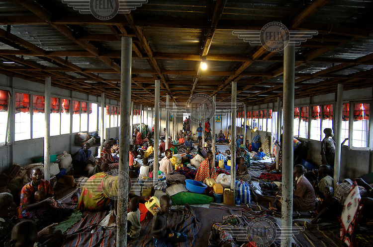 Dinka families sit in a cabin aboard a barge organised by IOM (International Organisation of Migration) and other UN (United Nations) bodies to resettle displaced persons after the civil war.  The two-day long journey up the River Nile will return Dinka tribespeople from Juba to their homeland of Bor.  Tens of thousands of Dinka tribespeople are among the estimated 3.8 million people displaced during the two-decade long conflict between the government and the SPLA (Sudanese People Liberation Army)..