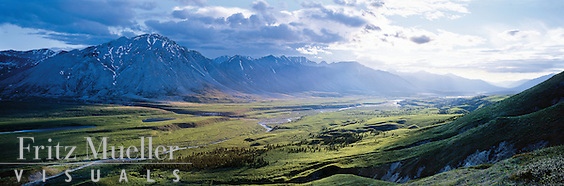 Midnight sun beams into the Snake River valley, Yukon