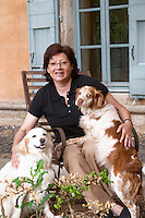 Chantal Lecouty with two of her dogs. Prieure de St Jean de Bebian. Pezenas region. Languedoc. In the garden. ex-Owner winemaker. France. Europe.