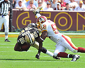 Landover, MD - September 14, 2008 -- New Orleans Saints running back Reggie Bush (25) is tackled by Washington Redskins linebacker Rocky McIntosh (52) in second quarter action at FedEx Field in Landover, Maryland on Sunday, September 14, 2008..Credit: Ron Sachs / CNP.(RESTRICTION: NO New York or New Jersey Newspapers or newspapers within a 75 mile radius of New York City)