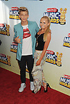 LOS ANGELES, CA- APRIL 27: Singer/songwriter Cody Simpson and actress Ali Simpson arrive at the 2013 Radio Disney Music Awards at Nokia Theatre L.A. Live on April 27, 2013 in Los Angeles, California.