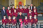 The pupil from Mr Moloneys class at Holy Family national school, Balloonagh, Tralee, who were confirmed on Friday in St Brendans Church, Tralee, by Bishop Bill Murphy. Front l-r: Ruairi OKelly, Nathan OLeary, Michael Dineen, Bishop Murphy, Jack Lynch, Ian McCoy and Dwyane Prendergast. 2nd l-r: Mr Liam Moloney, Marcus Nolan, Craig Murphy, Jordan Christie and Stephen McCarthy. Back l-r: Ciaran OReilly, David Fitzmaurice, Shane Walsh, Cian Hill, Mr Ed OBrien (principal), Jordan Fitzgerald OBrien, Maciek Morawk, Fr Patsy Lynch and Mark Donovan Walsh.