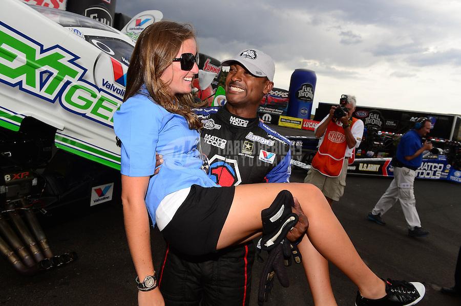 Jul, 22, 2012; Morrison, CO, USA: NHRA top fuel dragster driver Antron Brown celebrates with Megan Fessel Schumacher after winning the Mile High Nationals at Bandimere Speedway. Mandatory Credit: Mark J. Rebilas-