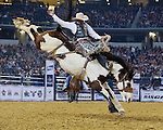 Jake Wright, Lunatic Fringe, Burch Rodeo, during the RFDTV American. Photo by Andy Watson