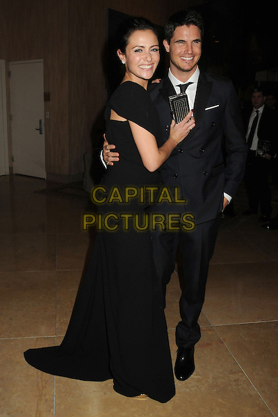 11 January 2015 - Beverly Hills, California - Italia Ricci, Robbie Amell. 72nd Annual Golden Globe Awards - Exits held at the Beverly Hilton Hotel. <br /> CAP/ADM/BP<br /> &copy;BP/ADM/Capital Pictures