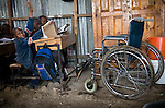 Braise in class, with his wheelchair next to his desk.<br />