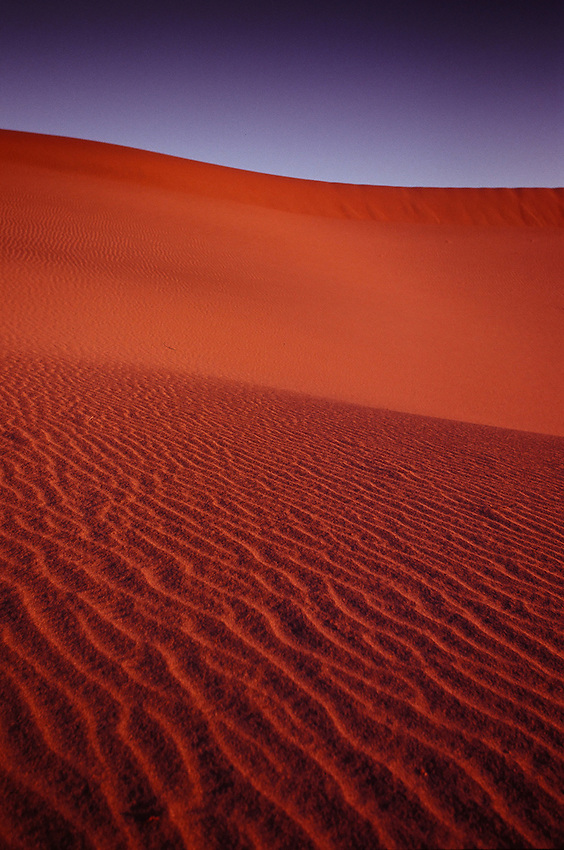 Sunrise on Mesquite Flat Sand Dunes, Death Valley, Ca.  35mm image on Velvia 100 film.