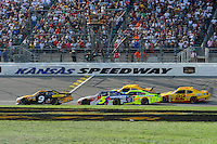 Marcos Ambrose (#9),Mark Martin (#5), Paul Menard (#27) `18 and Kurt Busch (#22) race under the checkered flag.