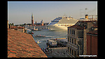 Italy, Venice. Ask for a Room with a View.<br /> I took Rick Steves' advice regarding inexpensive lodging with an incredible view. He was right. These cruise ships and their guests are in port from about 9AM to 4:30PM, so visit the most popular sites before and after. I call it anti-patterning.  Grand Canal near San Marco Square, Venice.