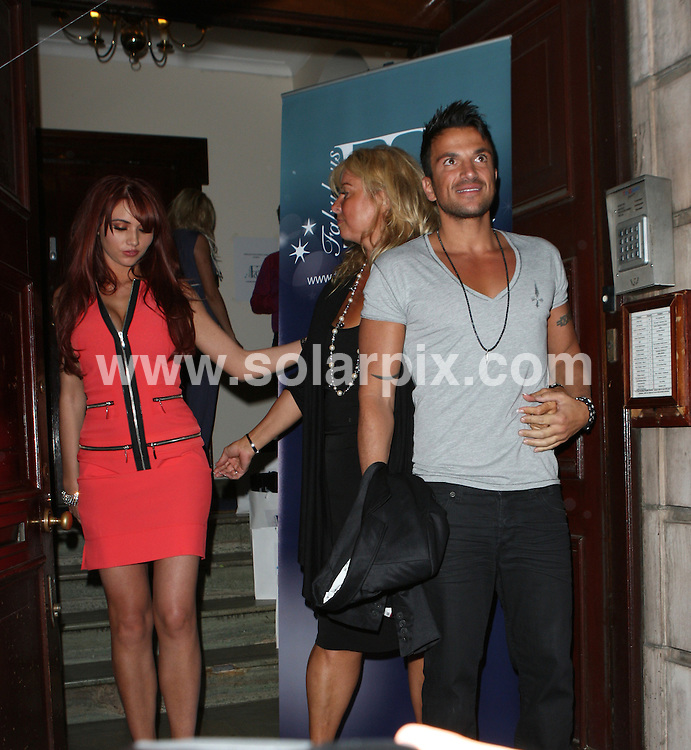 **ALL ROUND PICTURES FROM SOLARPIX.COM**                                             **WORLDWIDE SYNDICATION RIGHTS**                                                                                  Caption: Guests leaving the FAB Face & Body Clinic Launch party, held at No1 Harley street, London, UK. 17 May 2011                                                                             This pic: Peter Andre, Amy Childs, their manager Claire Powell from CAN Associates                                                                                       JOB REF: 13357 WMB       DATE: 17_05_2011                                                           **MUST CREDIT SOLARPIX.COM OR DOUBLE FEE WILL BE CHARGED**                                                                      **MUST AGREE FEE BEFORE ONLINE USAGE**                               **CALL US ON: +34 952 811 768 or LOW RATE FROM UK 0844 617 7637**