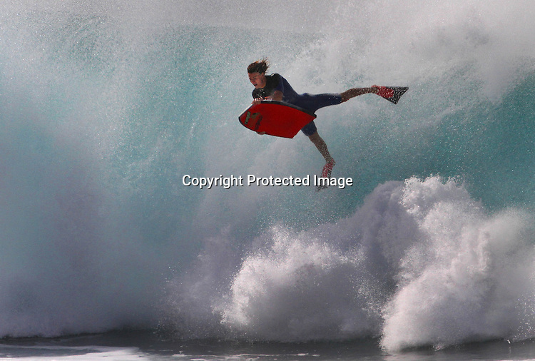 One boogie boarder over Presidents weekend seem to be having a ride of his life at Ehukai Beach (Banzai Pipeline) on the Northshore of Oahu, Hawaii.