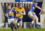 Clare's Enda Barrett gathers posession in midfield. Photograph by Declan Monaghan