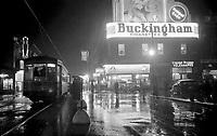 Oct 5, 1937 - <br /> St. Catherine Street Looking East. Montreal, Canada.<br /> <br /> FranÁais : Vue prise sous la pluie, en direction de l'est, de la rue Sainte-Catherine Ouest ‡ l'intersection du square Phillips ‡ MontrÈal. Nous voyons le tramway no 41 arrÍtÈ pour prendre des passagers. ¿ l'arriËre du tramway, nous remarquons un panneau publicitaire pour les cigarettes ´Sweet Caporalª. Nous apercevons Ègalement des magasins: ´American Drug Storeª, ´Canadian National Telegraphª et des panneaux publicitaires dont celui des cigarettes ´Buckinghamª. MontrÈal (Canada).<br /> 5 octobre 1937