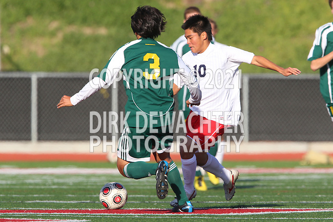 Redondo Beach, CA 02/01/10 - Gerardo Hernandez (Mira Costa #3) and Masaya Kawauchi (Redondo Union #10) in action during the Bay League Boys Varsity Soccer game between Mira Costa and Redondo Union.