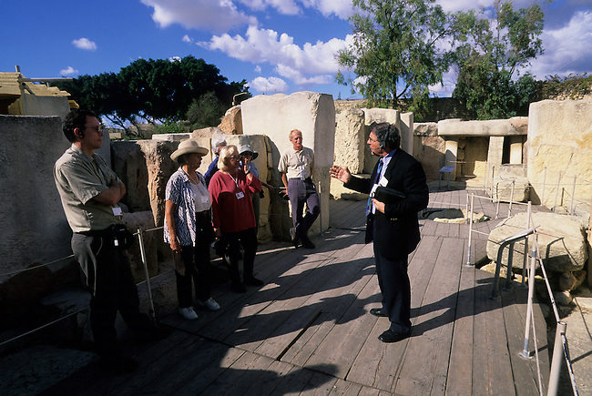MALTA, TARXIEN TEMPLES, SECOND TEMPLE OF TARXIEN, 2500 B.C., GUIDE WITH TOURISTS