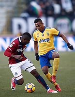 Calcio, Serie A: Bologna vs Juventus, stadio Renato D'Allara, Bologna,17 dicembre 2017.<br /> Bologna's Okwonkwo Orji (l) in action with Juventus' Alex Sandro (r) during the Italian Serie A football match between Bologna and Juventus at Bologna's Renato D'Allara stadium, December 17, 2017.<br /> UPDATE IMAGES PRESS/Isabella Bonotto