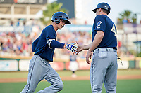 Mobile BayBears designated hitter Hutton Moyer (11) is congratulated by manager Lou Marson (4) as he rounds third base base after hitting a first inning home run during a game against the Jacksonville Jumbo Shrimp on April 14, 2018 at Baseball Grounds of Jacksonville in Jacksonville, Florida.  Mobile defeated Jacksonville 13-3.  (Mike Janes/Four Seam Images)