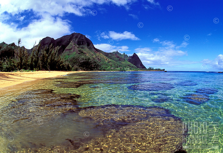Gorgeous clear water over the reefs at Tunnels beach near Haena on Kauai's north shore makes a perfect snorkeling destination.