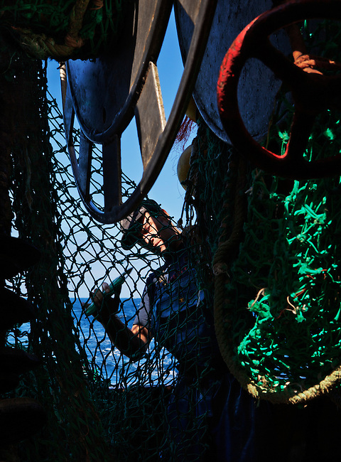 Carl Schryer, fisherman, working at sea aboard the trawler 'Risten', whose home port is Le Guilvinec, France. <br /> <br /> Le Guilvinec in Brittany is currently home to around 98 fishing boats, which makes the fishing industry and its shore-based support the economic pillar of the area.  <br /> <br /> However, in the last 15 years the fleet has decreased by approximately 30%, partly due to shrinking fish stocks, the low price of fish and the steep increase in fuel prices.<br /> <br /> Another main problem faced by the ports in this area is the shortage of trained crew.  This has major consequences on existing vessels and is a serious issue that is echoed throughout many fishing sectors in the E.U.