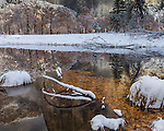 Yosemite National Park, California: Reflections along the Merced River after a snowfall, late fall.